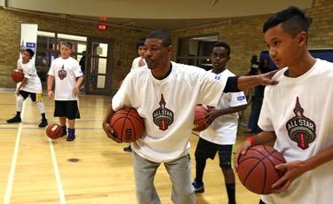 Former NBA player Muggsy Bogues instructs children during NBA All-Star KidsFest at the downtown YMCA in Winnipeg on Fri., Nov. 20, 2015. Kevin King/Winnipeg Sun/Postmedia Network