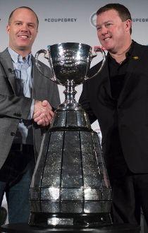 Ottawa Redblacks head coach Rick Campbell, left, shakes hands with Edmonton Eskimos head coach Chris Jones in Winnipeg on Wednesday, Nov. 25, 2015. The Redblacks will play the Edmonton Eskimos in the 103rd Grey Cup on Sunday. THE CANADIAN PRESS/Jonathan H