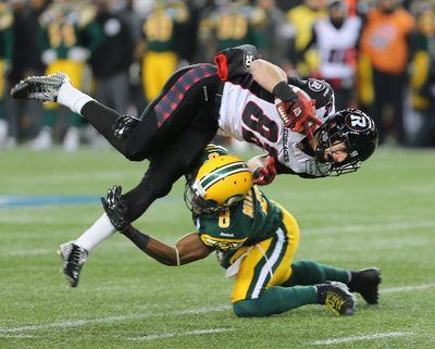 Ottawa RedBlacks wide receiver Greg Ellingson is taken down by Edmonton Eskimos safety Cauchy Muamba during CFL Grey Cup football in Winnipeg, Man. Sunday November 29, 2015. Brian Donogh/Winnipeg Sun/Postmedia Network