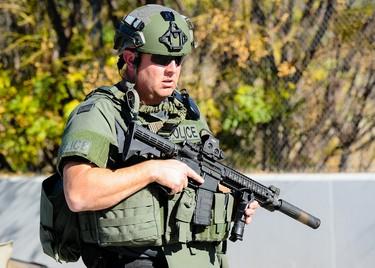 Police respond to the scene of an active shooting in San Bernardino, Calif. on Wednesday, Dec. 2, 2015. Police responded to reports of an active shooter at a social services facility.   (Rachel Luna/Los Angeles News Group via AP)