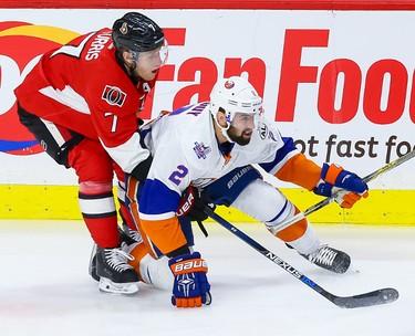Ottawa Senators center Kyle Turris (7) ties up New York Islanders defenseman Nick Leddy (2) during NHL action in Ottawa, Ont. on Saturday December 5, 2015. Errol McGihon/Ottawa Sun/Postmedia Network