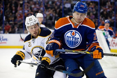 The Edmonton Oilers' Lauri Korpikoski (28) battles the Buffalo Sabres' Johan Larsson (22) during first period NHL action at Rexall Place, in Edmonton, Alta. on Sunday Dec. 6, 2015. David Bloom/Edmonton Sun/Postmedia Network