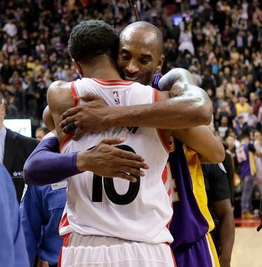 Raptors DeMar DeRozan hugs Los Angeles Lakers Kobe Bryant after Bryant plays last game at the ACC in Toronto, Ont. on Monday December 7, 2015. Craig Robertson/Toronto Sun/Postmedia Network