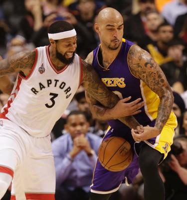 Raptors James Johnson battles Lakers  Roberts Sacre. Los Angeles Lakers Kobe Bryant plays last game at the ACC in Toronto, Ont. on Monday December 7, 2015. Craig Robertson/Toronto Sun/Postmedia Network