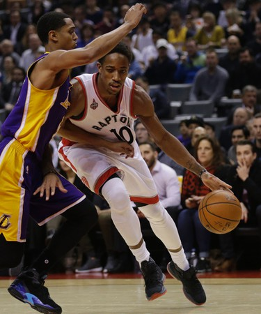 Raptors DeMar DeRozan drives to the net. Los Angeles Lakers Kobe Bryant plays last game at the ACC in Toronto, Ont. on Monday December 7, 2015. Craig Robertson/Toronto Sun/Postmedia Network