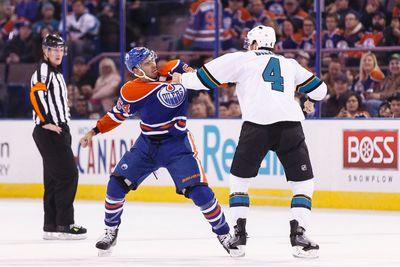 Edmonton forward Jujhar Khaira (54) fights San Jose defenceman Brenden Dillon (4) during a NHL game between the Edmonton Oilers and the San Jose Sharks at Rexall Place in Edmonton, Alta. on Wednesday December 9, 2015. Ian Kucerak/Edmonton Sun/Postmedia Network