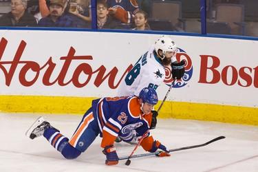 Edmonton centre Matt Hendricks (23) is taken down by San Jose defenceman Brent Burns (88) during the second period of a NHL game between the Edmonton Oilers and the San Jose Sharks at Rexall Place in Edmonton, Alta. on Wednesday December 9, 2015. Ian Kucerak/Edmonton Sun/Postmedia Network