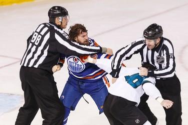 Edmonton forward Luke Gazdic (20) fights San Jose forward Mike Brown (18) during the second period of a NHL game between the Edmonton Oilers and the San Jose Sharks at Rexall Place in Edmonton, Alta. on Wednesday December 9, 2015. Ian Kucerak/Edmonton Sun/Postmedia Network