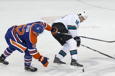 Edmonton defenceman Eric Gryba (62) battles San Jose forward Patrick Marleau (12) during the second period of a NHL game between the Edmonton Oilers and the San Jose Sharks at Rexall Place in Edmonton, Alta. on Wednesday December 9, 2015. Ian Kucerak/Edmonton Sun/Postmedia Network