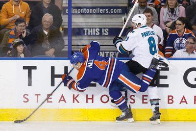 Edmonton forward Taylor Hall (4) battles San Jose centre Joe Pavelski (8) during the second period of a NHL game between the Edmonton Oilers and the San Jose Sharks at Rexall Place in Edmonton, Alta. on Wednesday December 9, 2015. Ian Kucerak/Edmonton Sun/Postmedia Network
