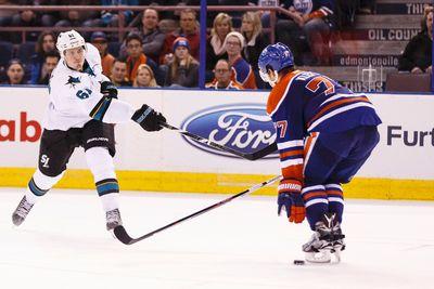 San Jose defenceman Justin Braun (61) fires a shot past Edmonton defenceman Oscar Klefbom (77) during the overtime period of a NHL game between the Edmonton Oilers and the San Jose Sharks at Rexall Place in Edmonton, Alta. on Wednesday December 9, 2015. Ian Kucerak/Edmonton Sun/Postmedia Network