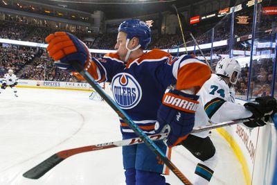 Edmonton centre Matt Hendricks (23) and San Jose defenceman Dylan Demelo (74) battle during the third period of a NHL game between the Edmonton Oilers and the San Jose Sharks at Rexall Place in Edmonton, Alta. on Wednesday December 9, 2015. Ian Kucerak/Edmonton Sun/Postmedia Network