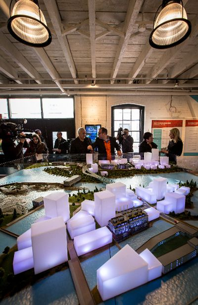 People look at the scale model of the Zibi development. Thursday December 10, 2015. Errol McGihon/Ottawa Sun/Postmedia Network