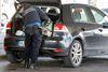 A Swiss border guard checks a car at the French-Swiss border due to a high level of alert,near Geneva, Switzerland, Friday, Dec. 11, 2015. (Salvatore Di Nolfi/Keystone via AP)