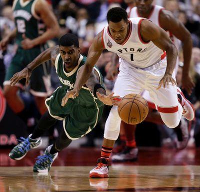 Toronto Raptors Kyle Lowry steals the ball from  Milwaukee Bucks O.J. Mayo  in Toronto, Ont. on Friday December 11, 2015. Craig Robertson/Toronto Sun/Postmedia Network