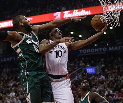 Toronto Raptors DeMar DeRozan goes to the basket against   the Milwaukee Bucks Greg Monroe in Toronto, Ont. on Friday December 11, 2015. Craig Robertson/Toronto Sun/Postmedia Network
