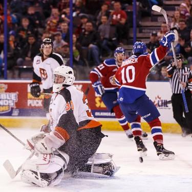 Edmonton's Tyson Gruninger (10) scores on Medicine Hat goaltender Mark Shields (30) during a WHL game between the Edmonton Oil Kings and the Medicine Hat Tigers at Rexall Place in Edmonton, Alta. on Sunday December 13, 2015. Ian Kucerak/Edmonton Sun/Postmedia Network