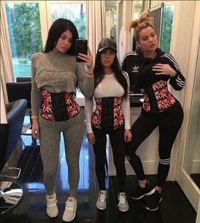 Kylie Jenner, Kourtney Kardashian and Khloe Kardashian pose in waist trainers. (instagram.com/kourtneykardash)
