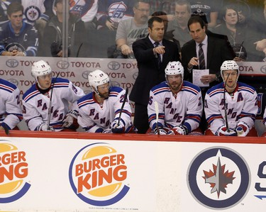 New York Rangers head coach Alain Vigneault and assistance coach Scott Arneil during first period NHL hockey action against the Winnipeg Jets' in Winnipeg, Friday, December 18, 2015. THE CANADIAN PRESS/Trevor Hagan