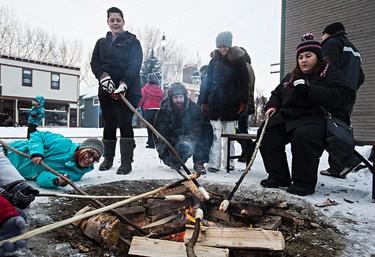 People make bannock during Fort Edmonton Park's Christmas Reflections in Edmonton, Alta., on Sunday, Dec. 20, 2015. Codie McLachlan/Edmonton Sun/Postmedia Network
