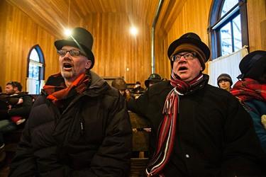 Choir members sing Christmas carols during Fort Edmonton Park's Christmas Reflections in Edmonton, Alta., on Sunday, Dec. 20, 2015. Codie McLachlan/Edmonton Sun/Postmedia Network