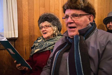 Freda Berg, left, and her husband, Dan Berg, right, sing Christmas carols during Fort Edmonton Park's Christmas Reflections in Edmonton, Alta., on Sunday, Dec. 20, 2015. Codie McLachlan/Edmonton Sun/Postmedia Network