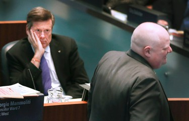 Toronto Mayor John Tory, with Councillor Rob Ford, on Wednesday, Feb. 11, 2015 during a council meeting in Toronto. (Veronica Henri/Toronto Sun)
