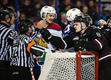 Edmonton's Brandon Baddock exchanges words with Red Deer's Kayle Doetzel during the Edmonton Oil Kings' WHL hockey game against the Red Deer Rebels at Rexall Place in Edmonton, Alta., on Monday, Dec. 28, 2015. Codie McLachlan/Edmonton Sun/Postmedia Network