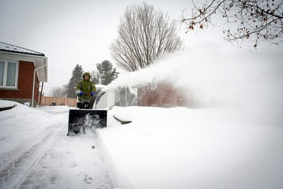 A man clears his driveway during the snowfall Tuesday, Dec. 29, 2015. Dani-Elle Dube/Ottawa Sun/Postmedia Network