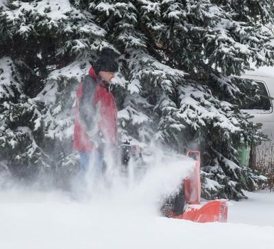 A man uses his snowblower during the first major snow fall of the season in Ottawa on Tuesday December 29, 2015. Errol McGihon/Ottawa Sun/Postmedia Network