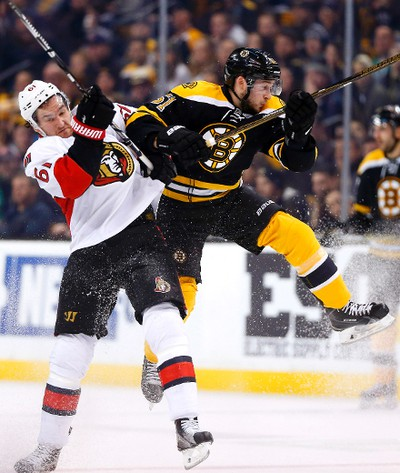 Dec 29, 2015; Boston, MA, USA; Boston Bruins center Ryan Spooner (51) collides into Ottawa Senators right wing Mark Stone (61) during the first period at TD Garden. Mandatory Credit: Winslow Townson-USA TODAY Sports