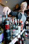 Emily Brucks, General Manager at Royal Liquor Merchants (Haysboro) examines product in the Calgary, Alta store on Sunday January 3, 2016. Jim Wells/Calgary Sun/Postmedia Network
