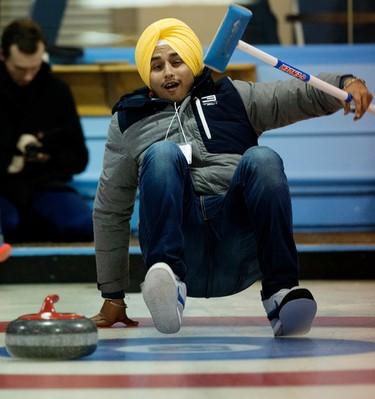 Anantvir Shandilya Vgas slips on the ice as NAIT international students try curling for the first time at the Avonair Curling Club, 10607 Princess Elizabeth Ave. , in Edmonton Alta. on Monday Jan. 4, 2016. David Bloom/Edmonton Sun/Postmedia Network