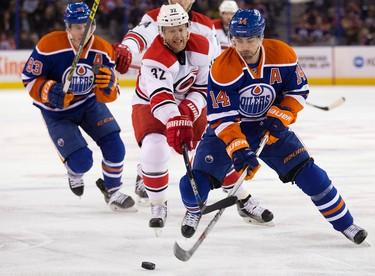 The Edmonton Oilers' Jordan Eberle (14) battles the Carolina Hurricanes Kris Versteeg (32) during first period NHL action at Rexall Place, in Edmonton Alta. on Monday Jan. 4, 2016. David Bloom/Edmonton Sun/Postmedia Network