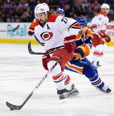 The Edmonton Oilers' Jordan Eberle (14) battles the Carolina Hurricanes Justin Faulk (27) during first period NHL action at Rexall Place, in Edmonton Alta. on Monday Jan. 4, 2016. David Bloom/Edmonton Sun/Postmedia Network