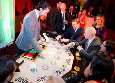 Jared Cowen deals a hand at the 2016 Ferguslea Senators Soiree Cuban Cabaret, the premier fundraising event of the Ottawa Senators Foundation was held on Tuesday, Jan. 5, at the Hilton Lac-Leamy in Gatineau, Que.  Ashley Fraser / Ottawa Sun