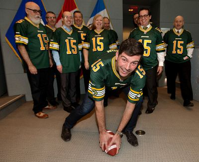 Mayor Don Iveson and the Edmonton City council show off their Edmonton Eskimos jerseys and pride prior to a council meeting at City Hall, in Edmonton, Alta. on Friday Nov. 27, 2015. David Bloom/Edmonton Sun/Postmedia Network