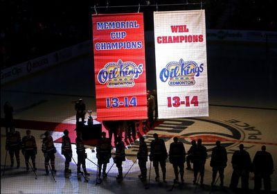 Members of the Edmonton Oil Kings look on as their WHL Championship banner and their Memorial Cup Championship banner are raised at Rexall Place, in Edmonton Alta., on Saturday Sept. 20, 2014. David Bloom/Edmonton Sun/QMI Agency