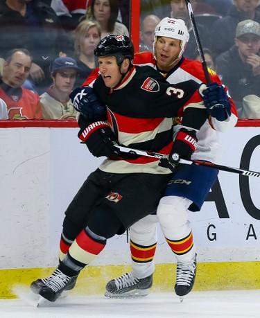Ottawa Senators defenseman Marc Methot (3) gets held up by Florida Panthers right wing Shawn Thornton (22) during NHL action in Ottawa, Ont. on Thursday January 7, 2016. Errol McGihon/Ottawa Sun/Postmedia Network