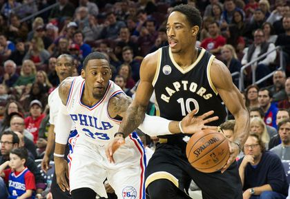 Toronto Raptors guard DeMar DeRozan (10) dribbles past Philadelphia 76ers forward Robert Covington (33) during the first quarter at Wells Fargo Center.  Bill Streicher-USA TODAY Sports
