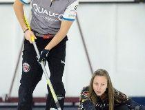 John Morris sweeps for teammate Rachel Homan