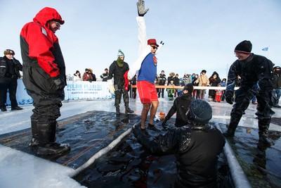 Aemulya Karwal dressed as Superman for the fifth annual Polar Plunge at Lake Summerside Beach Club in Edmonton, Alta., on Sunday January 17, 2016. Funds raised support the Law Enforcement Torch Run. Ian Kucerak/Edmonton Sun/Postmedia Network