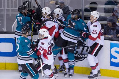 Jan 18, 2016; San Jose, CA, USA; San Jose Sharks left wing Matt Nieto (83) and Ottawa Senators center Zack Smith (15) in an altercation during the first period at SAP Center at San Jose. Mandatory Credit: Kelley L Cox-USA TODAY Sports