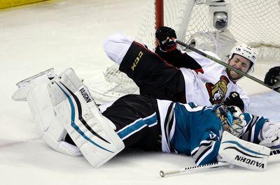 San Jose Sharks goalie Alex Stalock, bottom, collides with Ottawa Senators' Zack Smith during third period of an NHL hockey game Monday, Jan. 18, 2016, in San Jose, Calif. Ottawa won 4-3 in a shootout. (AP Photo/Marcio Jose Sanchez)