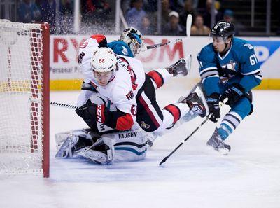 Jan 18, 2016; San Jose, CA, USA; Ottawa Senators left wing Mike Hoffman (68) collides into the goal post against San Jose Sharks goalie Alex Stalock (32) during the second period at SAP Center at San Jose. Mandatory Credit: Kelley L Cox-USA TODAY Sports