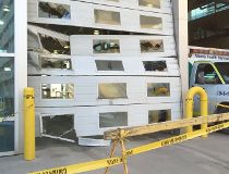 Damage to the bay doors at the Royal Alexandra Hospital after an ambulance was