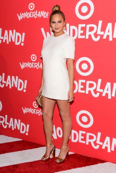 Featuring: Teigen goes all white in Victoria Beckham at a Target event. Dec. 8. (C.Smith/ WENN.com)