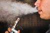 A man smokes an electronic cigarette vaporizer. (REUTERS/Mark Blinch/Files)