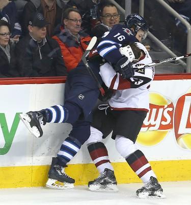 Winnipeg Jets left winger Andrew Ladd (l) checks Arizona Coyotes defenceman Oliver Ekman-Larsson during NHL hockey in Winnipeg, Man. Tuesday January 26, 2016. Brian Donogh/Winnipeg Sun/Postmedia Network