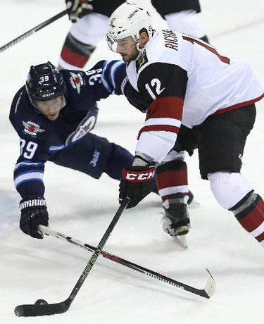 Winnipeg Jets defenceman Toby Enstrom (l) blocks a scoring attempt by Arizona Coyotes right winger Brad Richardson during NHL hockey in Winnipeg, Man. Tuesday January 26, 2016. Brian Donogh/Winnipeg Sun/Postmedia Network